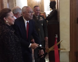 Retired Army Gen. Colin L Powell and his wife, Alma, cut the ribbon opening Powell Hall at the National War College on Fort Lesley J. McNair in Washington, D.C., as Marine Corps Gen. Joe Dunford, the chairman of the Joint Chiefs of Staff, looks on, Sept. 29, 2016. DoD photo by Jim Garamone
