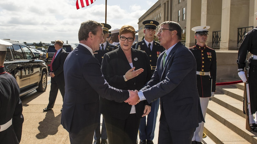 Defense Secretary Ash Carter, right, greets both Australian Defence Minister Marise Payne, center, and Christopher Pyne, the country's minister for defence industry, during an honor cordon at the Pentagon, Oct. 5, 2016. The leaders met to discuss matters of mutual importance. DoD photo by Army Sgt. Amber I. Smith