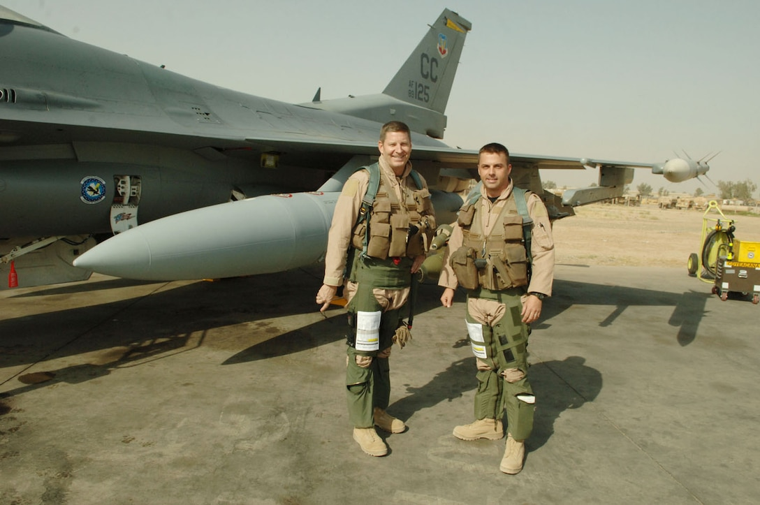 Maj. Troy Gilbert stands beside Gen. Robin Rand, the Air Force Global Strike Command commander, in front of the F-16 Fighting Falcon he was flying Nov. 27, 2006, when he was killed 30 miles southwest of Balad Air Base, Iraq. Gilbert served under Rand's command in the 332nd Air Expeditionary Wing at Balad AB in 2006. (Courtesy photo/Gilbert family)