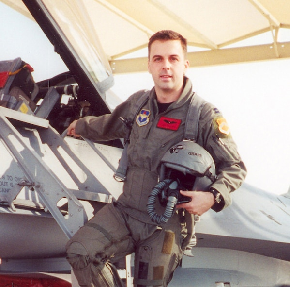 Maj. Troy Gilbert stands on the ladder of an F-16 at Luke Air Force Base, Ariz. Gilbert, an F-16 Fighting Falcon pilot, was killed Nov. 27, 2006, in an F-16 crash 30 miles southwest of Balad Air Base, Iraq. Gilbert was the standardization and evaluation chief for the 332nd Expeditionary Operations Group and was deployed from the 309th Fighter Squadron from Luke Air Force Base, Ariz. (Courtesy photo/Gilbert family)