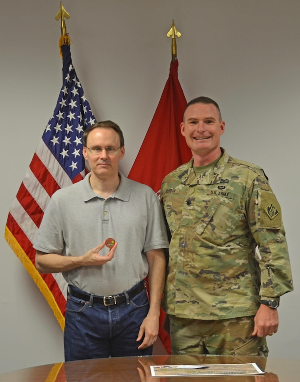 ALBUQUERQUE, N.M. – District Commander Lt. Col. James Booth recognized geographer Doug Walther for his GIS support to local fire and emergency management services, Oct. 3, 2016. The local fire/EMS community sought out assistance in creating a map book of the local Bosque area with all known hazards, routes, and fire hydrants identified. For half the cost of a commercial contract, Walther and the District supported the local services in order to allow them to effectively fight fires in the Bosque areas.