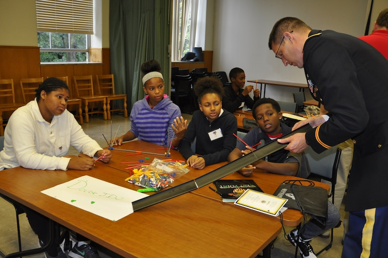 U.S. Army Corps of Engineers, Detroit District's Deputy District Commander, Scott Snyder instructs students on bridge design at the West Point Society of Michigan Leadership, Ethics and Diversity in STEM conference at Marygrove College. (U.S. Army Corps of Engineers Photo)