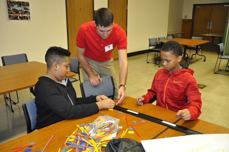Alec Higgins, U.S. Army Corps of Engineers, Detroit District engineer, instructs students on bridge building techniques at the West Point Society of Michigan Leadership, Ethics and Diversity in STEM conference at Marygrove College. (U.S. Army Corps of Engineers Photo)