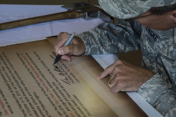 Col. Tom Palenske, commander of the 1st Special Operations Wing, signs the Fire Prevention Week Proclamation at Hurlburt Field, Fla., Oct. 5, 2016. Fire Prevention week was established in 1922 by President Woodrow Wilson and is the longest running public health and safety observance on record. (U.S. Air Force photo by Airman 1st Class Joseph Pick)