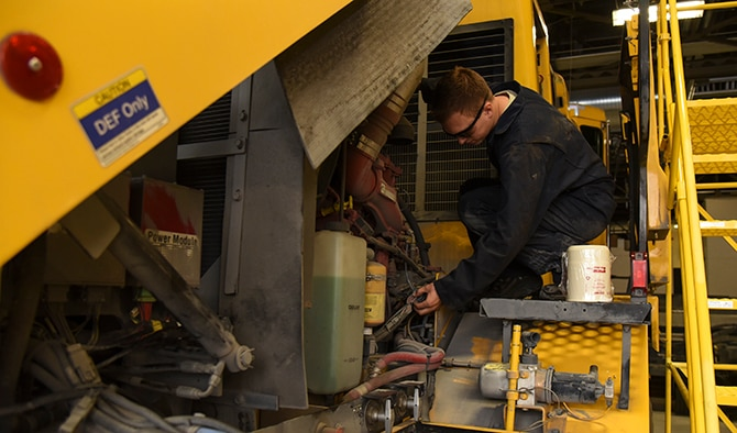 Senior Airman Tyler Karr, 92nd Logistics Readiness Squadron mission generation vehicle and equipment maintenance journeyman, verifies a snow broom is in good working condition Oct. 3, 2016, at Fairchild Air Force Base. Airmen change fluids, filters, safety items such as windshield wipers, conduct in-depth inspections and tire maintenance prior to the first snowfall.  (U.S. Air Force photo/Senior Airman Mackenzie Richardson)