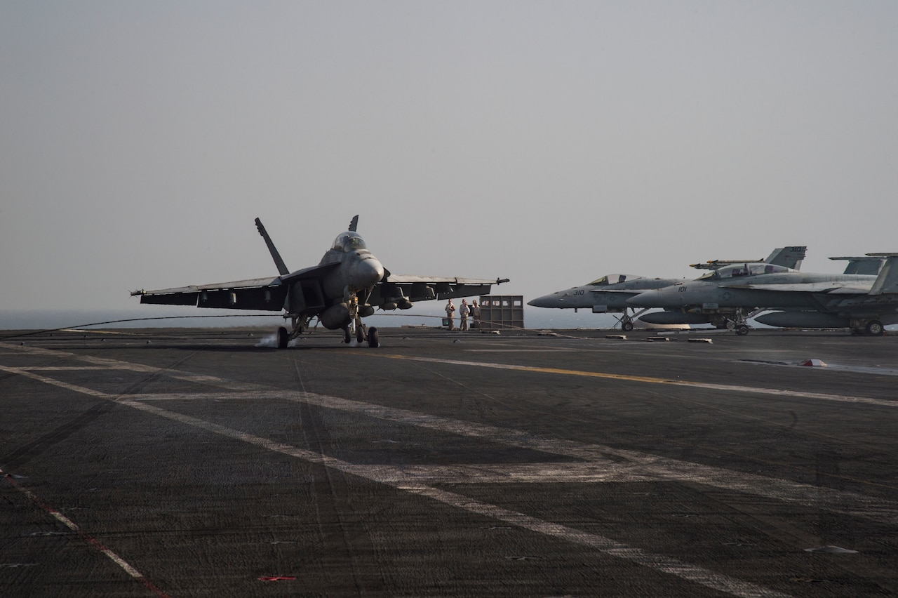 An F/A-18F Super Hornet makes an arrested landing on the flight deck of the aircraft carrier USS Dwight D. Eisenhower in the Persian Gulf, Oct. 4, 2016. The Eisenhower and its Carrier Strike Group are deployed in support of Operation Inherent Resolve in the U.S. 5th Fleet area of operations. Navy photo by Petty Officer 3rd Class Nathan T. Beard