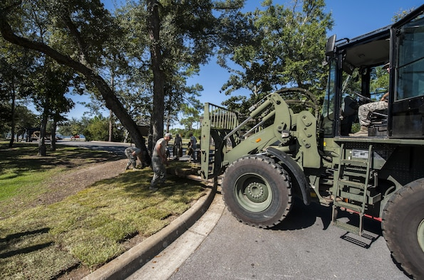 Airmen with the 1st Special Operations Civil Engineer Squadron lay sod at Hurlburt Field, Fla., Oct. 4, 2016. Civil engineer Airmen laid 34 pallets of sod outside the Soundside Club to replace dead grass. (U.S. Air Force photo by Airman 1st Class Joseph Pick)