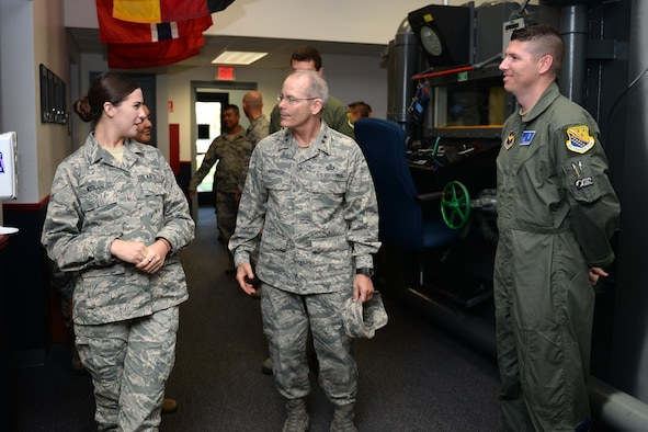 Maj. Gen. Robert Labrutta, 2nd Air Force commander, visits with Airman 1st Class Kristyn Widger, 82nd Aerospace Medicine Squadron aerospace physiology technician, for a tour of their spatial disorientation trainer at Sheppard Air Force Base, Texas, Oct. 5, 2016. The 82nd AMDS Airmen also shared other teaching methods they use to prepare student pilots for training. (U.S. Air Force photo by Senior Airman Kyle E. Gese)