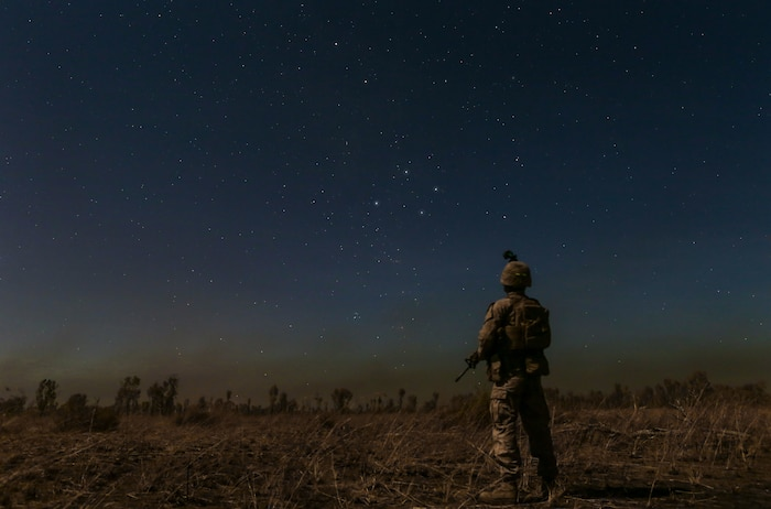 A Marine with Marine Rotational Force – Darwin stands under the Southern Cross star constellation during Exercise Koolendong 16 at Bradshaw Field Training Area, Northern Territory, Australia, Aug. 16, 2016. Koolendong is a trilateral exercise between the Australian Defence Force, U.S. Marine Corps and French Armed Forces New Caledonia. (U.S. Marine Corps photo by Sgt. Sarah Anderson)
