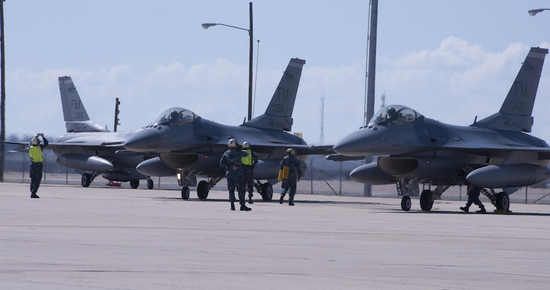 Sailors marshal eight F-16 Fighting Falcons from Homestead Air Reserve Base, Fla., Oct. 5, 2016 at Naval Air Station Fort Worth Joint Reserve Base, Texas. Twelve aircraft relocated here due to Hurricane Matthew's anticipated landfall. The base serves as a safe haven for military aircraft that are in the path of the hurricane. (U.S. Air Force photo by Tech. Sgt. Melissa Harvey)