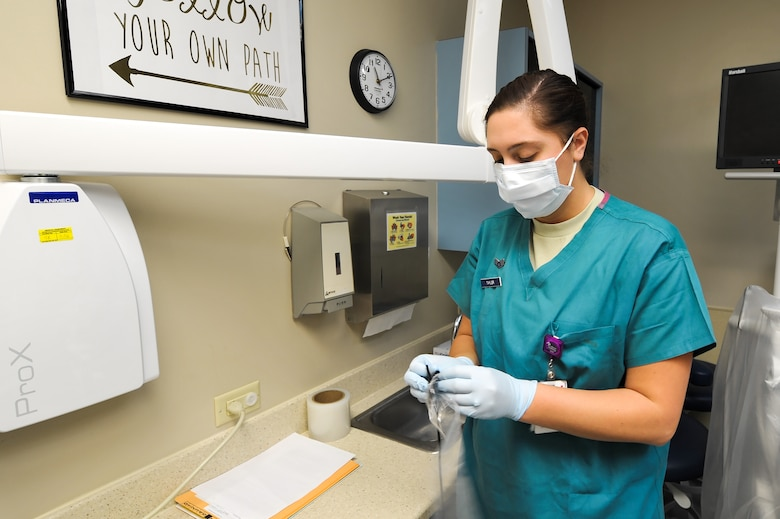 Senior Airman Ceiera Taylor, a dental technician with the 1st Special Operations Dental Squadron, prepares to take x-rays of a patient at Hurlburt Field, Fla., Oct. 4, 2016. Taylor takes x-rays for the dentist as part of an annual check-up for patients. (U.S. Air Force photo by Senior Airman Jeff Parkinson/Released)