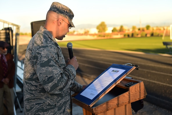 Col. David Miller Jr., 460th Space Wing commander, reads a domestic violence proclamation before a Domestic Violence Awareness Month 5K Run/Walk Oct. 5, 2016, at the outdoor track on Buckley Air Force Base, Colo. The event was held to generate conversation about the issue of domestic violence. (U.S. Air Force photo by Airman 1st Class Gabrielle Spradling/Released)