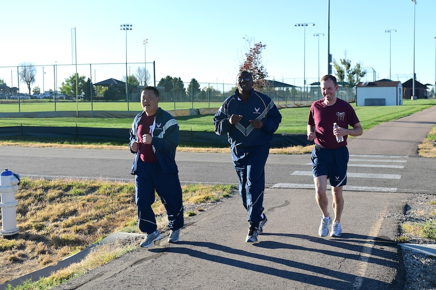 Members of the 460th Medical Group run during a Domestic Violence Awareness Month 5K Run/Walk Oct. 5, 2016, at the outdoor track on Buckley Air Force Base, Colo. The goal of the event was to raise awareness and advertise resources to minimize domestic violence in the United States because, according to National Coalition Against Domestic Violence statistics, nearly 20 people per minute are physically abused by an intimate partner. (U.S. Air Force photo by Airman 1st Class Gabrielle Spradling/Released)