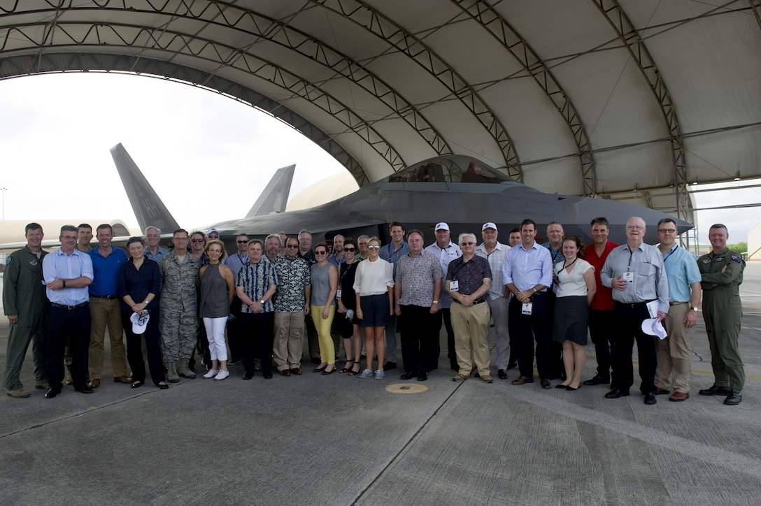 Delegates of the Australian American Leadership Dialogue (AALD) and Pacific Air Forces members pose for a photo in front of an F-22 Raptor during the delegation's visit to Joint Base Pearl Harbor-Hickam, Hawaii, Oct. 4, 2016. The AALD brings together U.S. and Australian leaders from government, enterprise, media, education and the community to build upon and improve bilateral relations. This year is the 9th Annual Honolulu Leadership Dialogue co-hosted by U.S. Pacific Command and the East-West Center. (U.S. Air Force photo by Staff Sgt. Alexander Martinez)