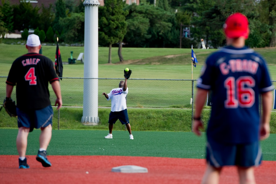 U.S. Air Force Chief Master Sgt. Thaddeus Brannon, 51st Medical Group superintendent, catches a fly ball during the Eagles vs. Chiefs softball game at Osan Air Base, Republic of Korea, Sept. 29, 2016. The Chiefs beat the Eagles 7-1 at the end of the three-inning game. (U.S. Air Force photo by Staff Sgt. Jonathan Steffen)