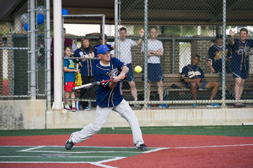 U.S. Air Force Col. Andrew Hansen, 51st Fighter Wing commander, swings for a hit during the Eagles vs. Chiefs softball game at Osan Air Base, Republic of Korea, Sept. 29, 2016. The Eagles vs. Chiefs game was one of many events during Osan Cup 2016, including basketball, volleyball and bowling. (U.S. Air Force photo by Staff Sgt. Jonathan Steffen)