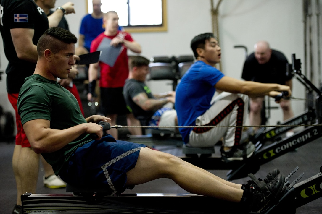 Team Osan members compete in a crossfit challenge during Osan Cup 2016 at Osan Air Base, Republic of Korea, Sept. 29, 2016. Osan Cup allowed units to work and compete together in a variety of sporting events. (U.S. Air Force photo by Staff Sgt. Jonathan Steffen)