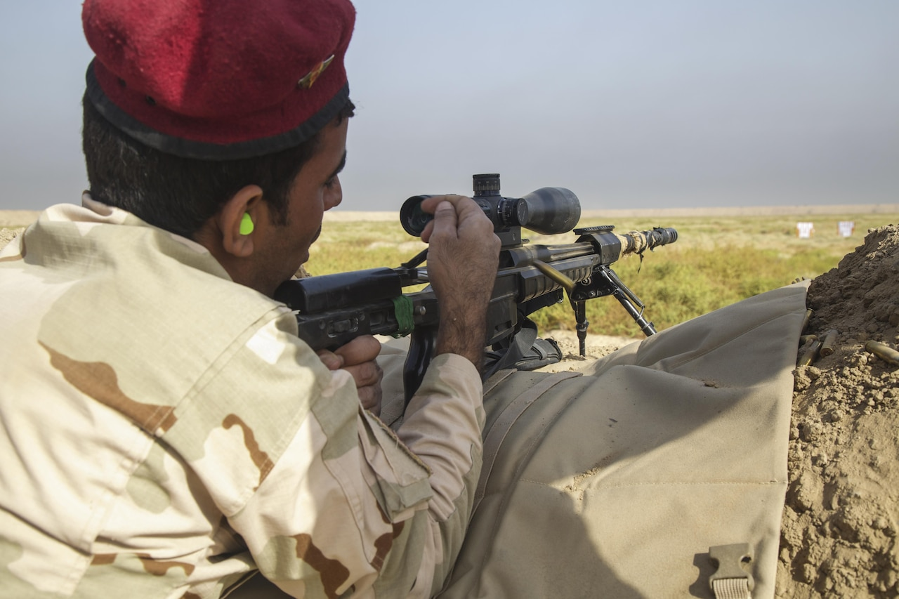 An Iraqi soldier assigned to the 76th Iraqi Army Brigade fires a sniper rifle during a live-fire range at Camp Taji, Iraq, Sept. 26, 2016. The range gave the Iraqi soldiers a chance to become more proficient with their weapons. This training is critical to enabling the Iraqi security forces to counter the Islamic State of Iraq and the Levant as they work to regain territory from the terrorist group.