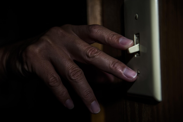 "This photo illustration of a light switch being turned off is a small step to saving energy as part of the Kadena Air Base energy awareness efforts. In 2012, President Barack Obama issued a presidential proclamation declaring October as National Energy Action Month. In the proclamation, Obama called upon Americans to work together ""to achieve greater energy security, a more robust economy, and a healthier environment for our children."" (U.S. Air Force Photo Illustration by Senior Airman Stephen G. Eigel)"