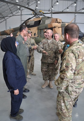 Lt. Gen. Jeffrey Harrigian, U.S. Air Forces Central Command commander and Air Component commander for CENTCOM, discusses the capabilities of the MD-530 Cayuse Warrior helicopter with members of the Afghan Air Force and Train, Advise, Assist Command-Air (TAAC-Air) during a visit to Kabul Air Wing, Afghanistan, Oct. 5, 2016. (U.S. Air Force photo by Capt. Jason Smith)