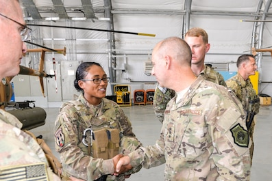 Lt. Gen. Jeffrey Harrigian, U.S. Air Forces Central Command commander and Air Component commander for CENTCOM, talks with Master Sgt. Deborah Enoch, 438th Air Expeditionary Wing command chief executive assistant, during his visit to Kabul Air Wing, Afghanistan, Oct. 5, 2016. (U.S. Air Force photo by Tech. Sgt. Christopher Holmes)
