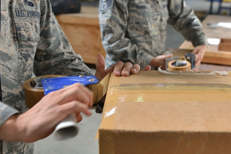 U.S. Air Force Airman 1st Class Daniel Josephson (left), 39th Logistics Readiness Squadron (LRS) traffic management journeyman and Staff Sgt. Amanda Olmos, 39th LRS outbound cargo noncommissioned officer in charge, prepare boxes for shipment Sept. 29, 2016, at Incirlik Air Base, Turkey. Cargo is packaged and accounted for prior to being transported. (U.S. Air Force photo by Senior Airman John Nieves Camacho)