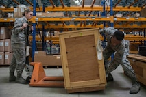 U.S. Air Force Airman Kennedy Trolinder (left), 39th Logistics Readiness Squadron (LRS) central storage apprentice, and Senior Airman Turon Boyd, 39th LRS service center journeyman, load cargo onto a pallet jack in the supply warehouse Oct. 4, 2016, at Incirlik Air Base, Turkey. The warehouse contains a broad spectrum of items to support base units and agencies. (U.S. Air Force photo by Senior Airman John Nieves Camacho)