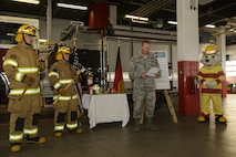 """U.S. Air Force Col. Joseph McFall, 52nd Fighter Wing commander, reads the 2016 Fire Prevention Week proclamation at the base fire department on Spangdahlem Air Base, Germany, Oct. 5, 2016. This years Fire Prevention Week will be observed Oct. 9-15 with the theme """"Don't wait - Check the Date."""" The emphasis is on replacing batteries yearly in all smoke alarms and replacing the alarms themselves every 10 years. (U.S. Air Force photo by Staff Sgt. Jonathan Snyder)"""