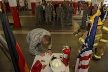 """U.S. Air Force Col. Joseph McFall, 52nd Fighter Wing commander, signs the 2016 Fire Prevention Week proclamation at the base fire department on Spangdahlem Air Base, Germany, Oct. 5, 2016. This years Fire Prevention Week will be observed Oct. 9-15 with the theme """"Don't wait - Check the Date."""" The emphasis is on replacing batteries yearly in all smoke alarms and replacing the alarms themselves every 10 years. (U.S. Air Force photo by Staff Sgt. Jonathan Snyder)"""