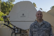 U.S. Air Force Lt. Col. Timothy Meerstein, 39th Communications Squadron (CS) commander, poses for a photo in front of a communication satellite dish Sept. 30, 2016, at Incirlik Air Base, Turkey. The 39th CS provides communications needs across the installation. (U.S. Air Force photo by Senior Airman John Nieves Camacho)