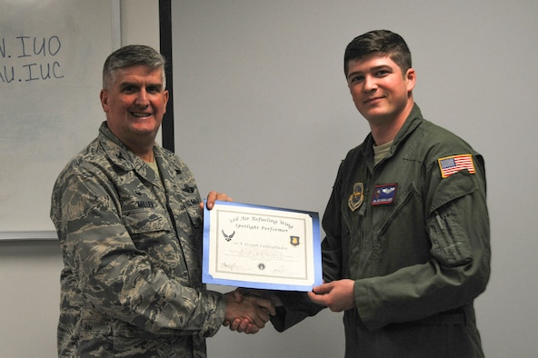 Senior Airman Joseph Cadwallader, 349th Air Refueling Squadron boom operator, poses with Col. Albert Miller, 22nd Air Refueling Wing commander, Oct. 4, 2016, at McConnell Air Force Base, Kan. Cadwallader received the spotlight performer for the week of Sept. 12-16. (U.S. Air Force photo/Airman 1st Class Jenna K. Caldwell)