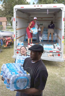 Sailors from the Navy Medicine Training Support Center, or NMTSC, at JBSA-Fort Sam Houston, unload bottled water at a church in Lafayette, La., as part of a donation drive to help victims of the Louisiana flood Sept. 24. Overall, 3,840 bottles of water and more than 150 pounds of non-perishable food items, clothing and cleaning supplies were gathered and donated to the area.