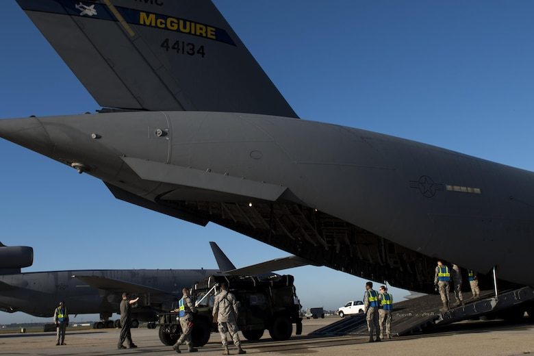 Airmen from the 6th Airlift Squadron and the 305th Aerial Port Squadron load a Humvee onto a C-17 Globemaster III at Joint Base McGuire-Dix-Lakehurst, N.J., Oct. 6, 2016. Mission partners at JB MDL provided the 621st Contingency Response Wing with mobility support as they sent more than 30 Airmen to Haiti in support of disaster relief operations in response to Hurricane Matthew.