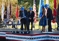 Medal of Honor recipient Thomas Kelley lifts a ceremonial shovel at the Minnesota Medal of Honor Memorial groundbreaking ceremony Oct. 3.