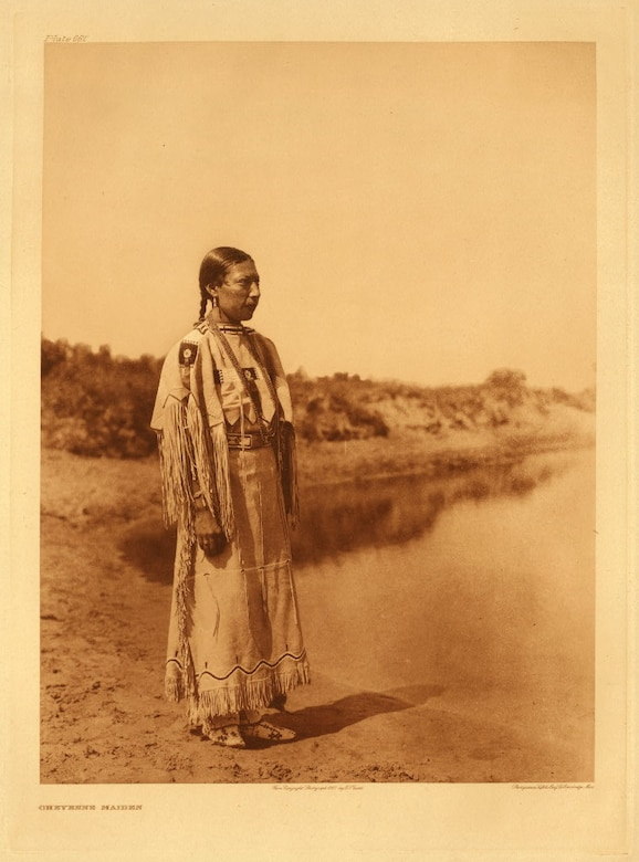 A Cheyenne maiden stands near water, Wyoming. (Courtesy photo)