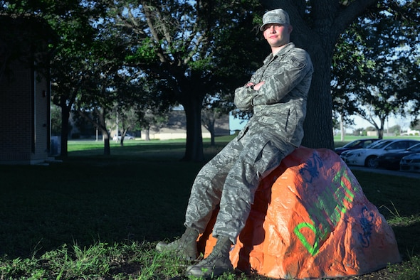 Senior Airman Daniel Clouse, 47th Communications Squadron cyber transport technician, sits on the 47th CS rock on Laughlin Air Force Base, Texas, Sept. 28, 2016. Clouse was chosen by wing leadership as this week's XLer for his outstanding contributions to his unit and Laughlin. (U.S. Air Force photo/Airman 1st Class Benjamin N. Valmoja)