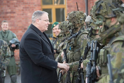 "Deputy Defense Secretary Bob Work greets Finnish defense forces in Helsinki, Oct. 6, 2016. En route to Finland, Work commented on what he called a ""humanitarian catastrophe"" in Aleppo, Syria. DoD photo by Navy Petty Officer 1st Class Tim D. Godbee"