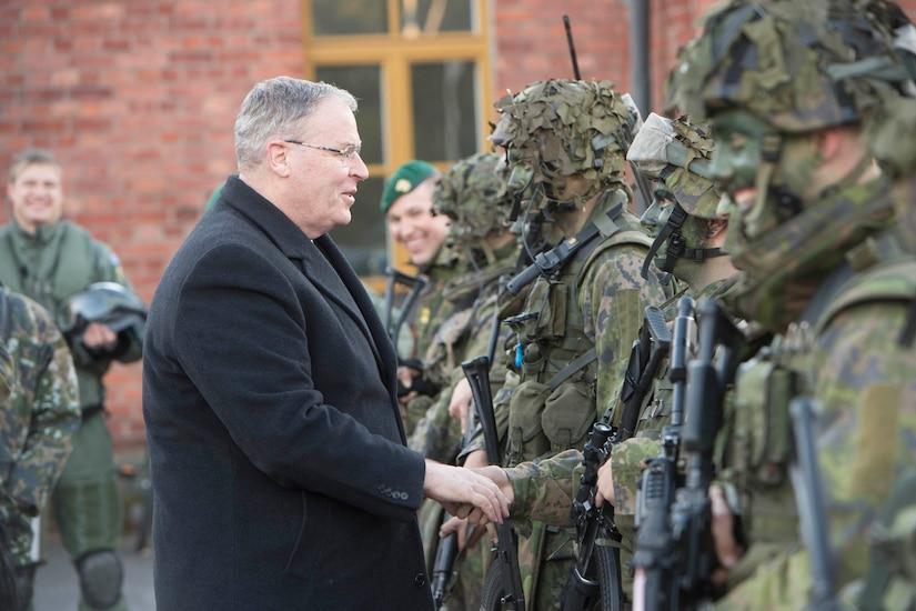 Deputy Defense Secretary Bob Work greets Finnish Defense Forces in Helsinki, Finland, Oct. 6, 2016. DoD photo by Navy Petty Officer 1st Class Tim D. Godbee