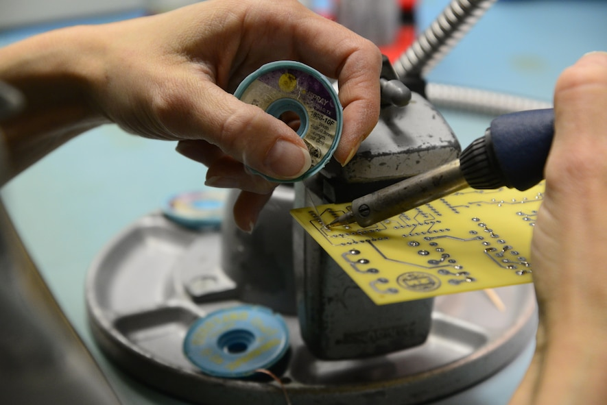 A student assigned to the 372nd Training Squadron, Detachment 11, Miniature and Microminiature (2M) Circuit Card Repair course solders a circuit card at Davis-Monthan Air Force Base, Ariz., Oct. 3, 2016. The 2M program is a part of the U.S. Navy program, but can be applied to multiple airframes in the U.S. Air Force. (U.S. Air Force photo by Senior Airman Betty R. Chevalier)