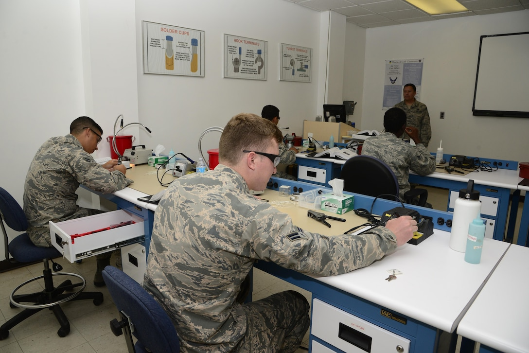 Students at the 372nd Training Squadron, Detachment 11 complete an assignment after receiving instruction at Davis-Monthan Air Force Base, Ariz., Oct. 3, 2016. The 372nd TRS, Det. 11 has three programs consisting of 69 courses to expand the skills of aircraft maintainers. (U.S. Air Force photo by Senior Airman Betty R. Chevalier)