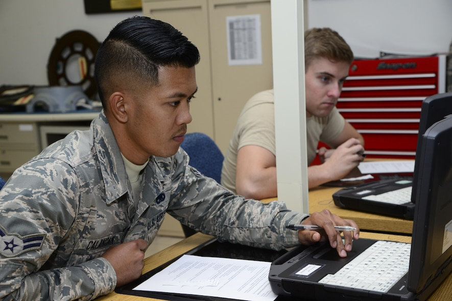 U.S. Air Force Airmen 1st Class Allan Calangan and Chandler Brown, 755th Aircraft Maintenance Squadron aerospace propulsion apprentices, work on a progress check exam during a course at the 372nd Training Squadron, Detachment 11 at Davis-Monthan Air Force Base, Ariz., Oct. 3, 2016. The students and teacher complete the progress check exams to ensure material comprehension. (U.S. Air Force photo by Senior Airman Betty R. Chevalier)