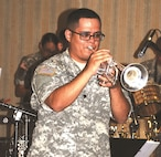 Spc. Dennis Montano of the 1st Infantry Division Brass Band renders a trumpet solo during a number the band played at the 2016 Hispanic Heritage Observance Sept. 21 at Riley's Conference Center.