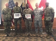 """The senior leadership of the 2nd Armored Brigade Combat Team, 1st Infantry Division, recognized Sgt. Maj. Francisco Gonzalez, 1st Inf. Div. Surgeon Cell, and Staff Sgt. Raheem Barthell, Company C, 299th Brigade Support Battalion, 2nd ABCT,"""" 1st Inf. Div., with Certificates of Appreciation to following their participation during Fort Riley's Hispanic Heritage Observance Sept. 21 at Riley's Conference Center. From left to right are Col. David W. Gardner, brigade commander, 2nd Armored Brigade Combat Team, 1st Infantry Division, Gonzalez, Barthell, Spc Tucker Day of the 1st Infantry Division Brass Band and Command Sgt. Maj. Craig Copridge, senior noncommissioned officer, 2nd ABCT, 1st Inf. Div."""