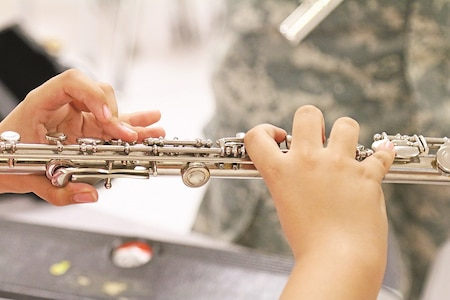 A band student at West Point Middle School practices her fingerings during a community outreach by 1st Infantry Division Band members Sept. 9 in West Point, New York. The students, mostly fifth-graders, received one-on-one instruction from members of the band.