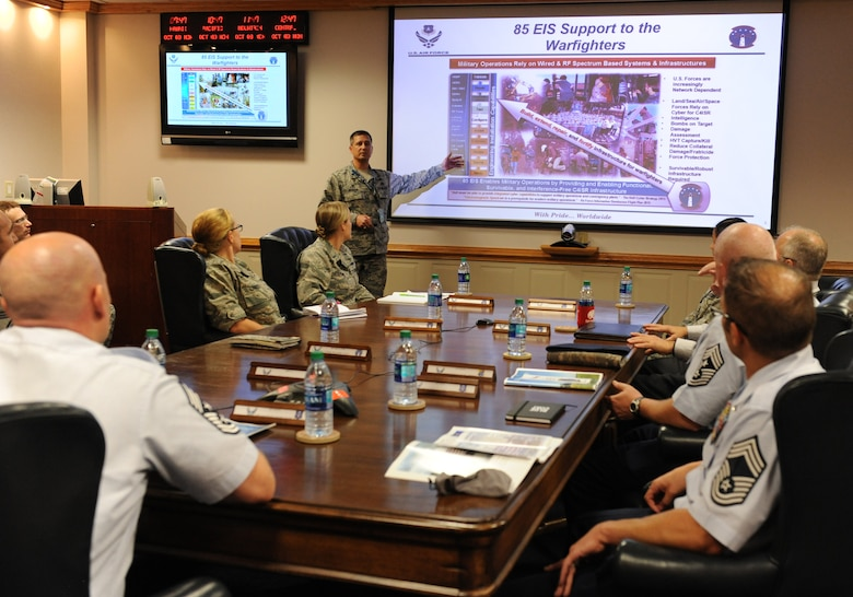 Lt. Col. Scott Jensen, 85th Engineering Installation Squadron commander, delivers a mission brief at Maltby Hall to 24th Air Force, Lackland Air Force Base, Texas, leadership during a site visit Oct. 3, 2016, on Keesler Air Force Base, Miss. The 24th AF leadership visited Keesler to familiarize themselves with how the Air Force trains cyber career field Airmen. (U.S. Air Force photo by Kemberly Groue/Released)
