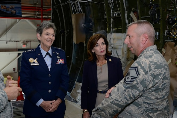 Senior Master Sgt. Dennis Pitcher briefs Gen. Ellen M. Pawlikowski, Air Force Materiel Command commander, and New York Lieutenant Governor Kathy Hochul on the C-5M interior refurbishment mission Oct. 5 at Stewart Air National Guard Base, N.Y. The two leaders met with Airmen and observed operations at the New York Air National Guard's 105th Airlift Wing. A total of 52 C-5 aircraft are being converted to the C-5M Super Galaxy configuration which includes avionics upgrades, new engines and other performance and reliability enhancements. The last step is a complete 40-day refurbishment of the aircraft interior performed by Total Force Airmen at Stewart. Pitcher is superintendent of C-5M refurb operations with the 105th AW. (U.S. Air Force photo/Staff Sgt. Julio A. Olivencia Jr.)