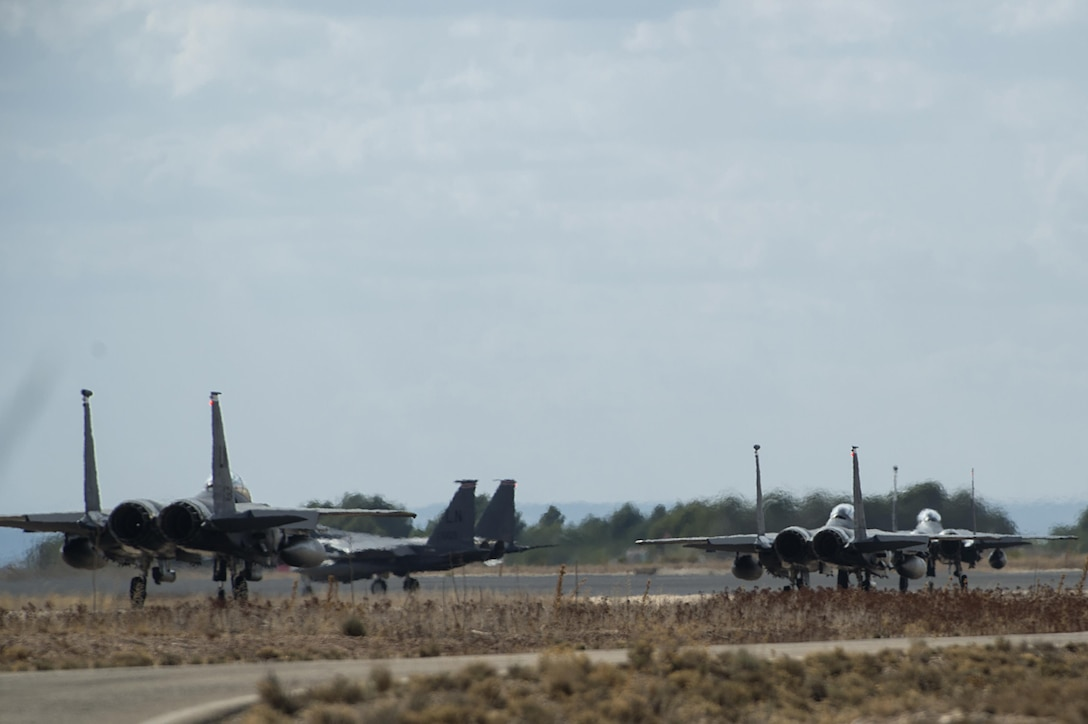 F-15E Strike Eagles, assigned to the 494th Fighter Squadron from Royal Air Force Lakenheath, England, taxi for a sortie in support of Tactical Leadership Programme 16-3 at Los Llanos Air Base, Spain, Sept. 26. Training programs like TLP showcase how the U.S. works side-by-side with NATO Allies and partners every day, training to meet future security challenges as a unified force. (U.S. Air Force photo/ Staff Sgt. Emerson Nuñez)