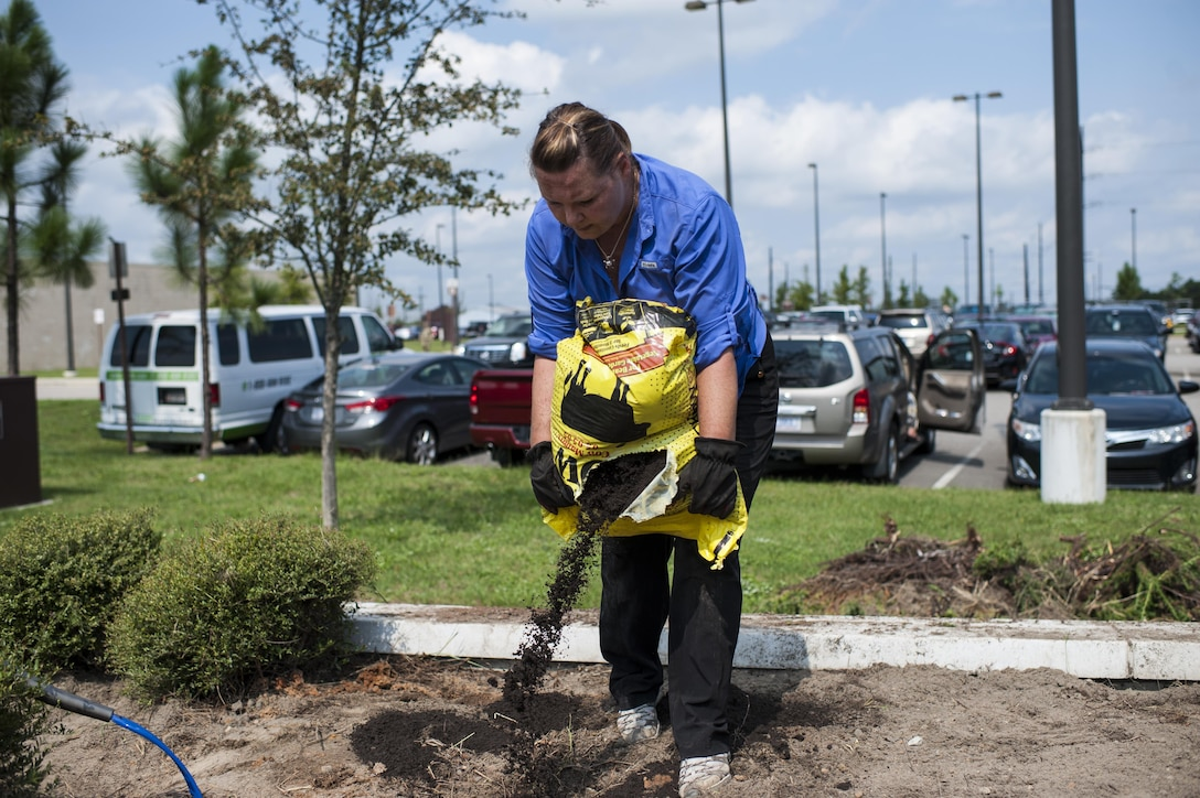 U.S. Army Reserve personnel with the Army Reserve Installation Management Directorate clean out old plants and bushes from existing planter boxes replacing them with Spring, Summer, and Fall perennials as part of National Public Lands Day at the U.S. Army Forces Command/U.S. Army Reserve Command headquarters, Sept. 28, 2016, at Fort Bragg, N.C. Jonelle Kimbrough, a communications specialist with ARIMD, said USARC received a $4,000 grant through the NPLD program. NPLD is the nation's largest, single-day volunteer effort for public lands to promote environmental stewardship. (U.S. Army photo by Timothy L. Hale)(Released)