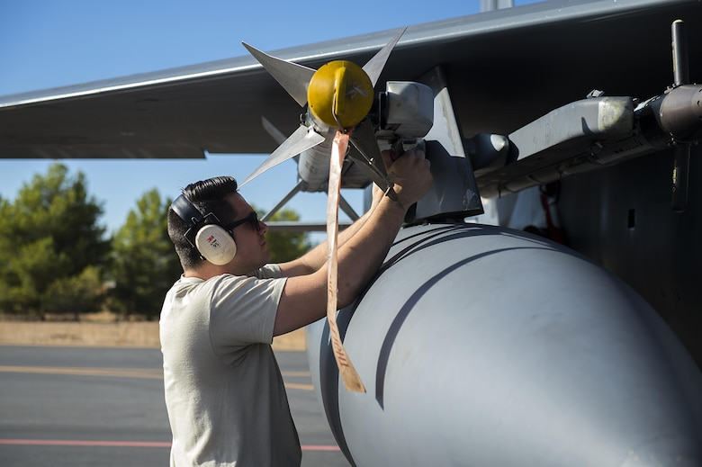 U.S. Air Force Staff Sgt. Zachory Restor, 48th Aircraft Maintenance Squadron aircraft armament system technician, reconnects an AIM-9M umbilical during Tactical Leadership Programme 16-3 at Los Llanos Air Base, Spain, Sept. 19. The training prepares NATO and allied forces' flight leaders to serve as mission commanders, lead coalition force air strike packages, and provide tactical air expertise to NATO agencies. (U.S. Air Force photo/ Staff Sgt. Emerson Nuñez)