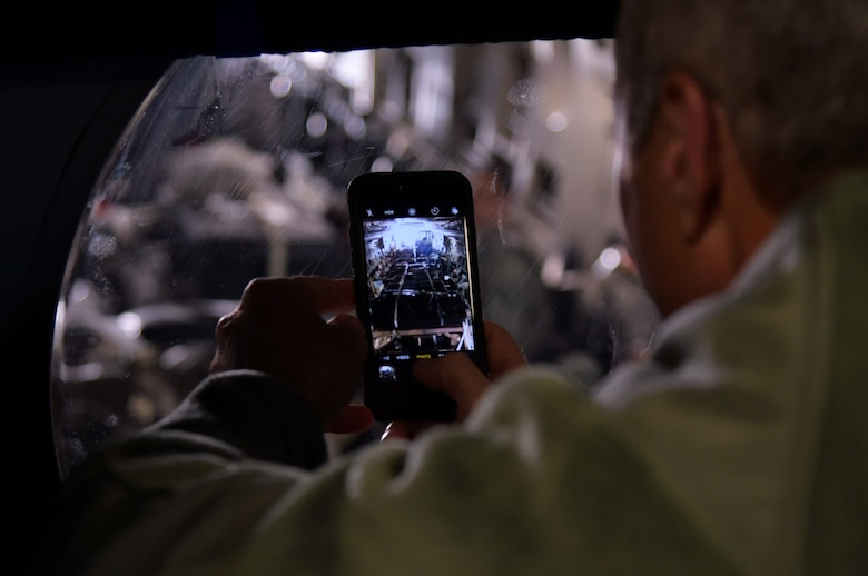 Col. Chuck Henderson, 621st Contingency Response Wing commander, takes a photo of Airmen assigned to the CRW in a C-17 Globemaster III before they depart to support humanitarian relief efforts in Port-au-Prince, Haiti, October 6, 2016. The CRW is supporting the government of Haiti's request for humanitarian assistance. (U.S. Air Force photo by Tech. Sgt. Gustavo Gonzalez/Released)